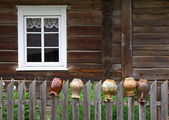 Rural house and old jugs — Stock Photo