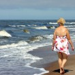 Elder woman on the beach — Stock Photo