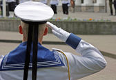 Soldier salutes — Stock Photo