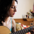 Young woman playing guitar — Stock Photo #3876734