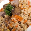 Pilaf with meat - Stock Photo
