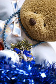 Soft bear with Christmas decorations — Stock Photo
