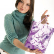 Young girl with shopping bag — Stock Photo