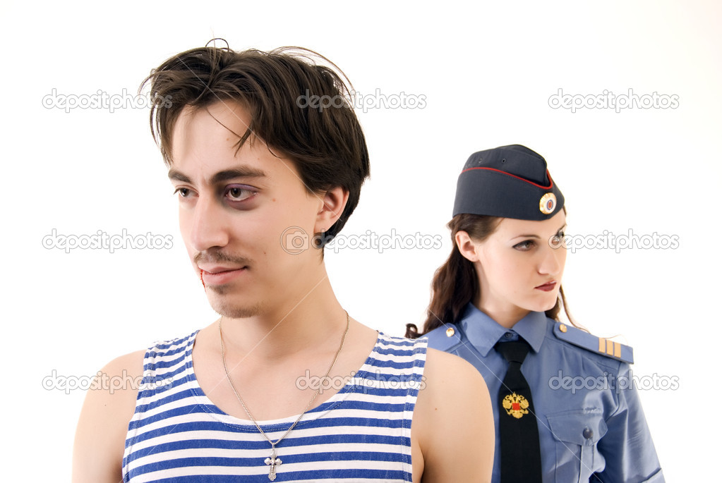 Policeman and criminal in foreground  — Stock Photo #4531771