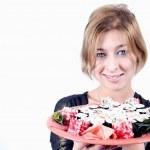 Girl with sushi — Stock Photo