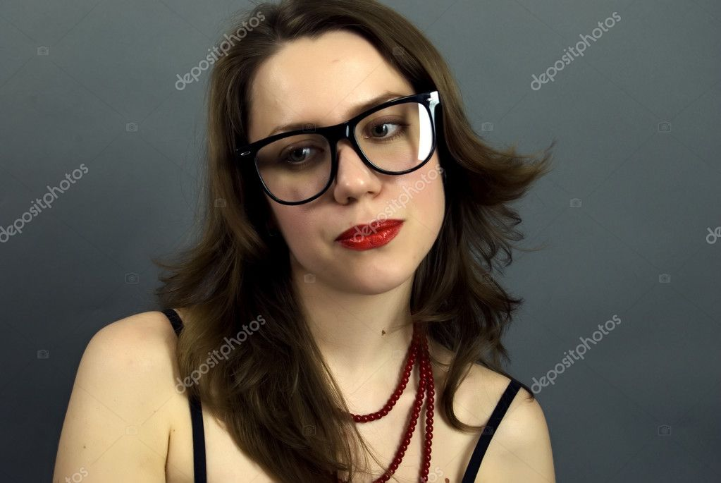 Portrait of a young beautiful brunette in glasses — Stock Photo #4691071