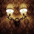 Photo of wall lamp with dim light - Stock Photo