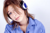 Young girl in headphones — Stok fotoğraf