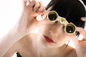 Young girl with binoculars — Stock Photo