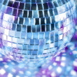 Shiny disco ball in blue light — Stock Photo