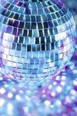 Shiny disco ball in blue light — Stock Photo