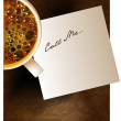 Coffee cup with a note — Stock Vector