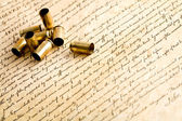 Bullet casings on bill of rights — Stock Photo