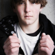 Handcuffed teen portrait - Stock Photo