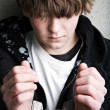 Teen crime - kid in handcuffs — Stockfoto