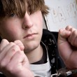 Teen in handcuffs - crime - Stock Photo