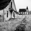 Abandoned house and church — Stock Photo