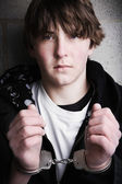 Handcuffed teen portrait — Stock Photo