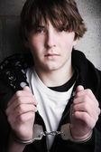 Handcuffed teen portrait — Stock Photo