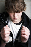 Teen crime - kid in handcuffs — Stock Photo