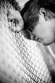Depression - teen against fence — Stock Photo