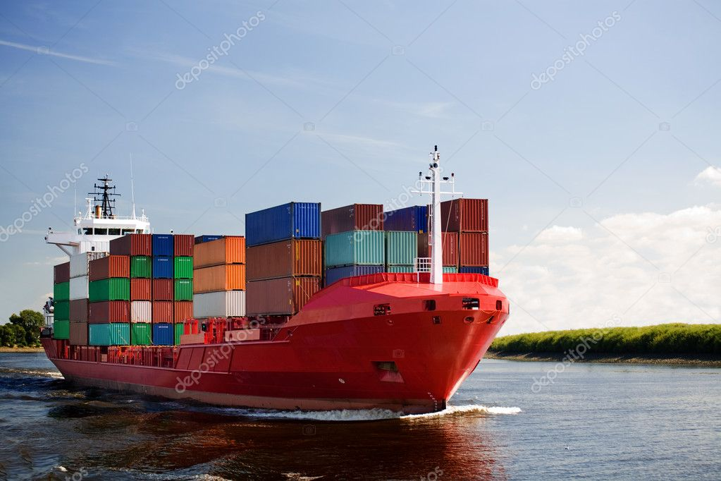 Cargo container ship - freighter navigating river — Stock Photo #3892824