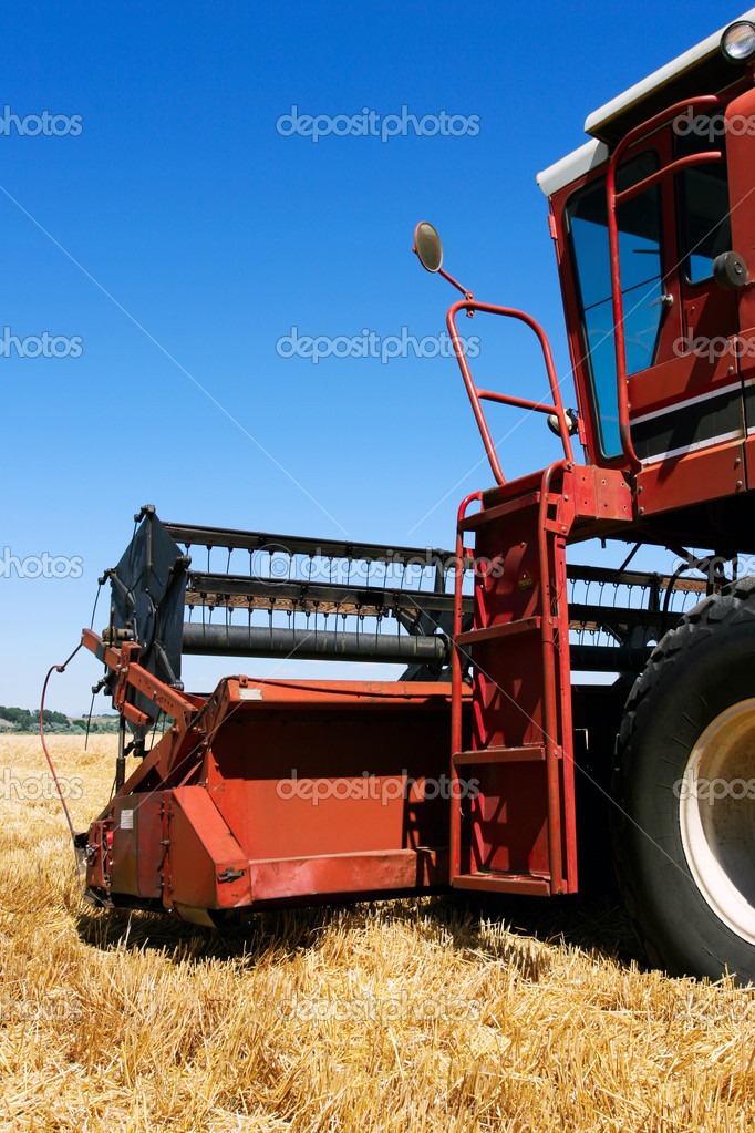 Combine harvester closeup on field under blue sky — Stock Photo #3892867