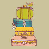 Suitcases with a bird — Stock Vector
