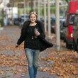 Pretty woman walking on the street — Stock Photo