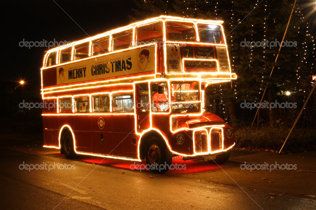 A red christmas bus on the road — Stock Photo #3884196