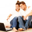 Young couple with laptop — Stock Photo #3910422