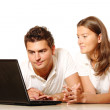 Young couple using a laptop — Stock Photo