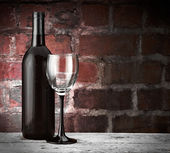 Wine glass and bottle — Stock Photo
