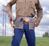 Man with tool belt — Stock Photo