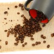 Stock Photo: Coffee beans and black cup