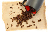 Coffee beans and black cup — Stock Photo