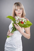 Bride with bouquet of lily — Stock Photo