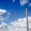 Fence and sky - Stock Photo