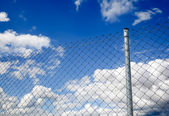 Fence and sky — Stock Photo