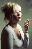 Portrait of beautiful smoking woman — Stock Photo