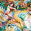 Stock Photo: Chinese God Fighting with Dragon Sculpture Painting on wall.