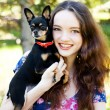 Teen girl with a small dog in the hands — Stock Photo