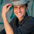 Young man in a hat greetings — Stock Photo