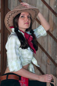 Girl in a cowboy hat — Stock Photo