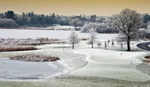 Winter cold scenic landscape lake with castle in distance, irela — Stock Photo