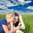 Stock Photo: Two women reading sms