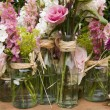 Flowers in jam jars — Stock Photo