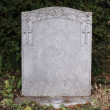Single grave stone - Stock Photo