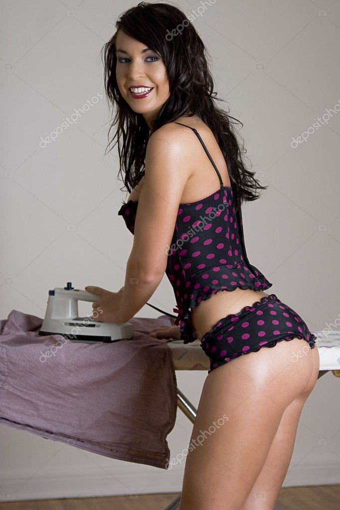 Young twenty something women in pokedot lingerie ironing a man shirt — Stock Photo #4234290
