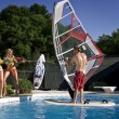 2 girl a guy and a pool — Stock Photo #4319553